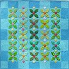 "</p> <p><center><a href=""http://auribuzz.wordpress.com/2011/01/06/january-aurifil-designer-susan-brubaker-knapp-lets-meet-susan-and-see-her-amazing-leaves-of-green-project/"" target=""_blank"">Susan Brubaker Knapp</a></center>"