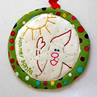 "</p> <p><center><a href=""http://thelastpiece.typepad.com/the_last_piece/2012/11/a-stitchy-christmas-ornament.html"" target=""_blank"">Sarah Fielke</a></center>"
