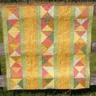 "</p> <p><center><a href=""http://auribuzz.wordpress.com/2011/11/02/november-aurifil-designer-of-the-month-jacquelynne-steves/"" target=""_blank"">Jacquelynne Steves</a></center>"